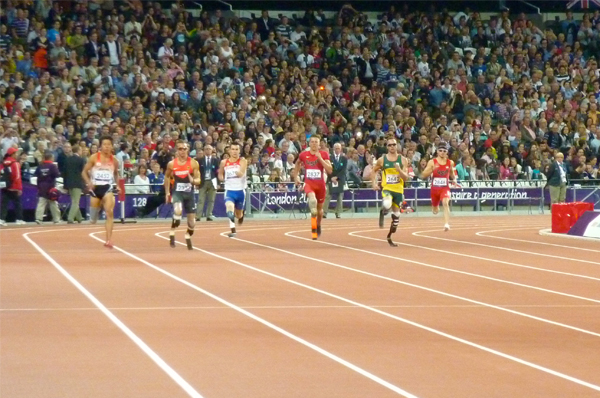 Athletes on the track in the Men's 400m T44 competition