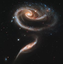 UGC_1810_and_UGC_1813_in_Arp_273_(captured_by_the_Hubble_Space_Telescope)