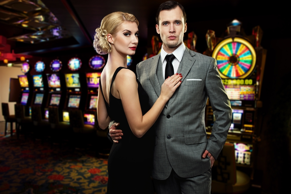 Retro couple against slot machines